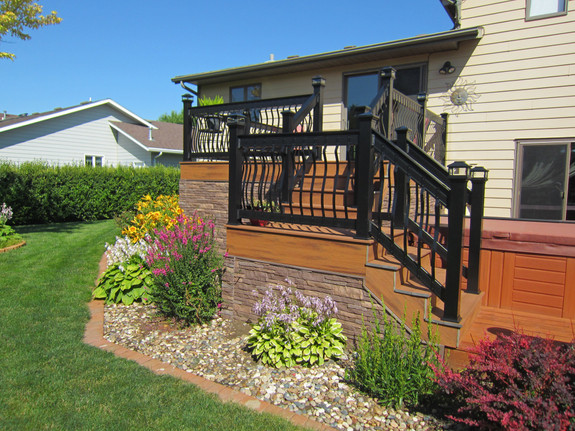Nailon Dry Stack siding in the sedona buff color used to panel this backyard deck.