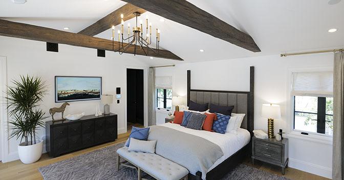 Beams on ceiling of bedroom