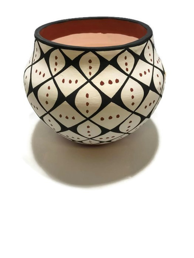 Mary Garcia Antonio is from the Acoma Pueblo Tribe and she creates traditional handcoiled pottery using the methods passed down to her by her ancestors.