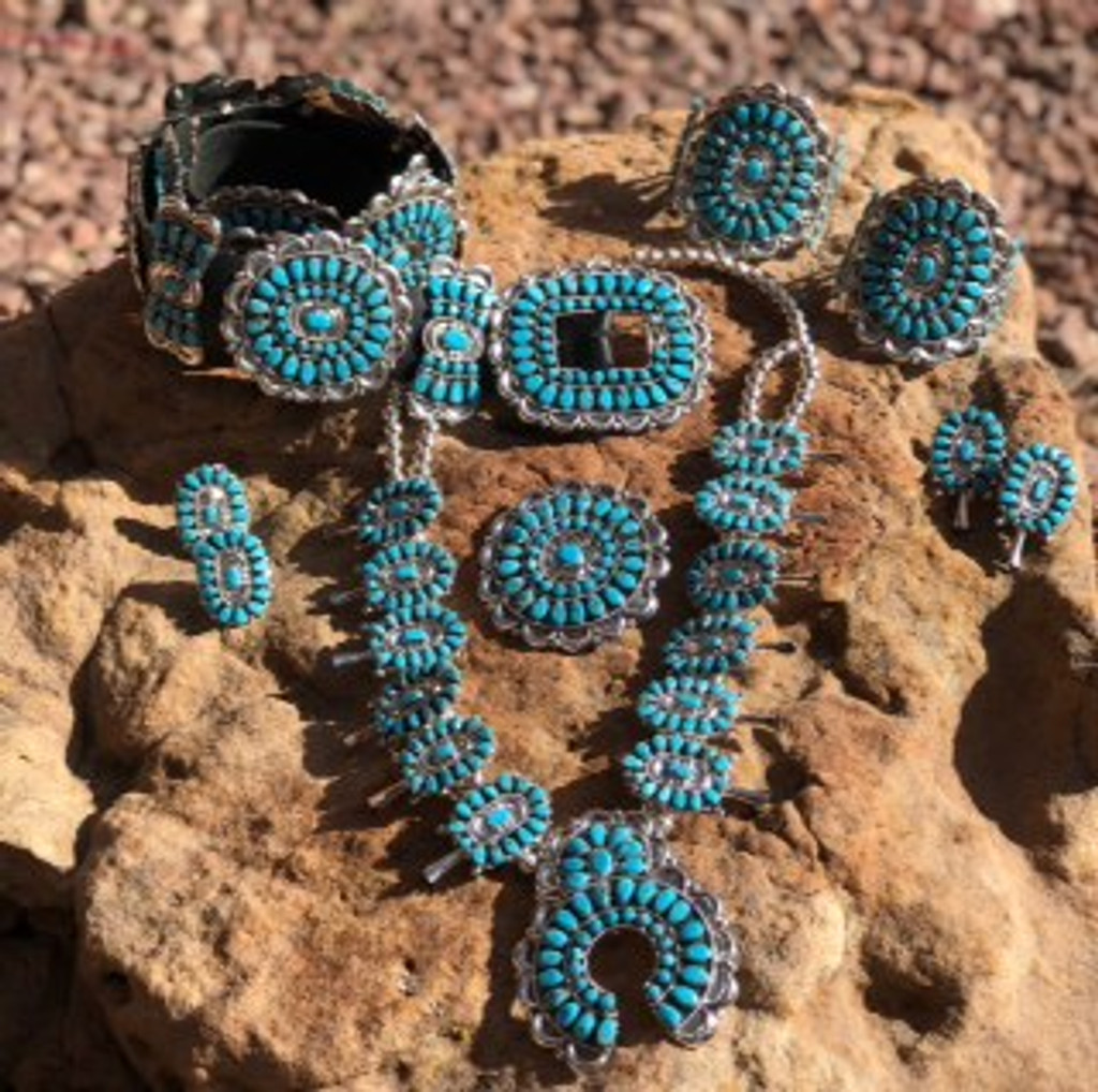 Traditional Navajo Turquoise Concho Belt, Squash Blossom, Two Cluster Bracelets, Two Rings, Pair of Earrings, And a Pin