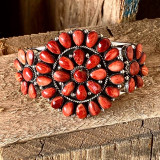 Vibrant red spiney oyster in this beautiful, traditional cluster cuff. Created by Navajo artist Loretta Delgarito