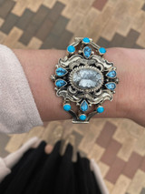 Star burst cut white topaz, swiss blue topaz, and sleeping beauty turquoise. This is a WOW piece! Created by the talented Emerson Delgarito