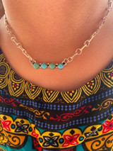 Cute little 4 stone bar necklace. Featuring Kingman turquoise, sterling silver, and created by Navajo artist Jerome Lee
