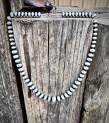 "24"" Graduated Stamped Navajo Pearls"