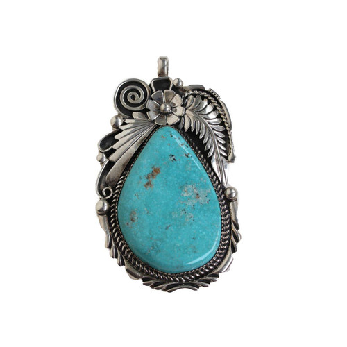 Beautiful handmade pendant in a tear drop shape.  Hand picked turquoise in a silver floral setting.