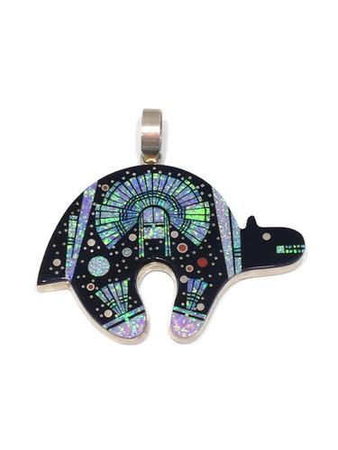 Navajo made inlay pendant by artist Clayton Tom.