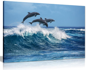 Dolphins jumping over waves