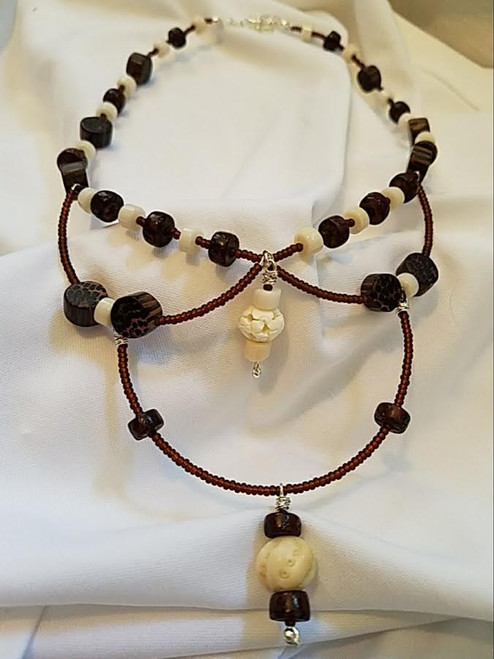 Wood, Bone, and Coral 3 Tier necklace