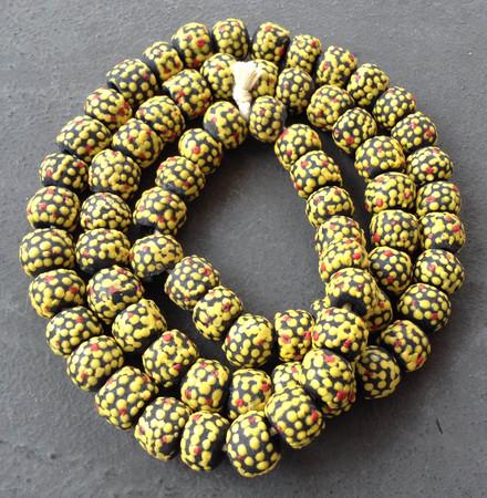 Black with raised yellow dots African fancy Krobo Powderglass beads