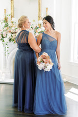 Model Left: Beth, Size: 20, Color: Romantic Blue  Model Right: Saije, Size: 4, Color: Dusty Blue