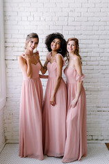 Model on Left: Grace, Size: 2, Color: Antique Blush  Model in the Middle: Carneshia, Size 2, Antique Blush  Model on Right: Lindsey, Size: 4, Color: Antique Blush