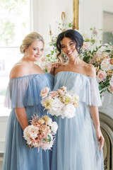 Model on Left: Beth, Size: 20, Color: French Blue Model on Right: Kamilah, Size: 2, Color: Powder Sky