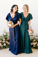 Model on Left: Claudia, Size: 16, Color: Navy Blue | Model on right: Britt, Size: 4, Color: Classic Emerald