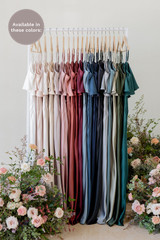 Flynn is available in White Pearl, Blush, Soft Champagne, Gold Champagne, Taupe, Rose Quartz, Desert Rose, Cinnamon Rose, Terracotta Rust, Cabernet, French Blue, Romantic Blue, Indie Blue, Navy Blue, Black, Silver, Eucalyptus, Silver Sage, Deep Olive, Classic Emerald (named from left to right).