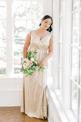 Model: Claudia; Size: 16; Color: Champagne Gold Sequin