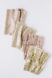Sequin fabric by the yard. Pictured in Matte Rose Gold, Champagne Gold, Rose Gold and Gold.
