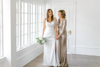 Model: Debby; Size: 4; Color: Matte Champagne Sequin (Left: pictured with Rory, White Pearl Satin dress)
