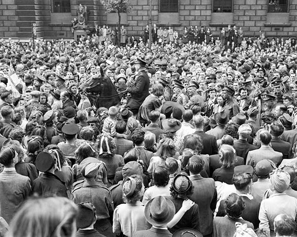 VE Day Commemorative Photo - crowd gathered to hear Winston Churchill's victory speech.  Available as a photo, poster or canvas.