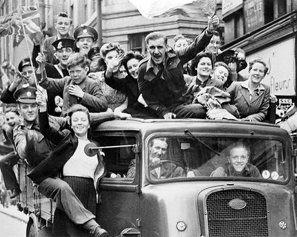 VE Day Commemorative Photo - truck of revellers celebrating VE Day 1945.  Available as a photo, poster or canvas.