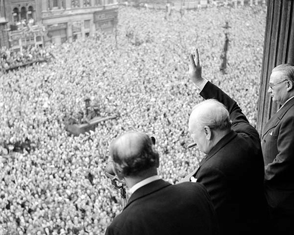 VE Day Commemorative Photo - Winston Churchill showing victory sign to crowd VE Day 1945. Available as a photo, poster or canvas.