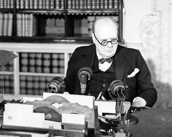 Winston Churchill sat in front of microphone ready to deliver victory speech on VE Day 1945.  Available as a photo, poster or canvas.