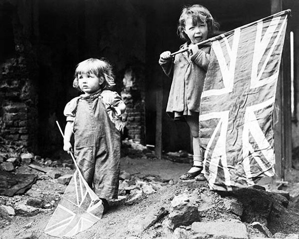 Two young girls waving Union Jacks on VE Day 8th May 1945. Available as a photo, poster or canvas.