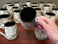 One Random Lunar/Asteroid Mug with black interior, roughly 10-14 ounces, Inspired by lunar surfaces