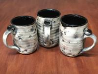 One Random Lunar/Asteroid Mug with Black Interior