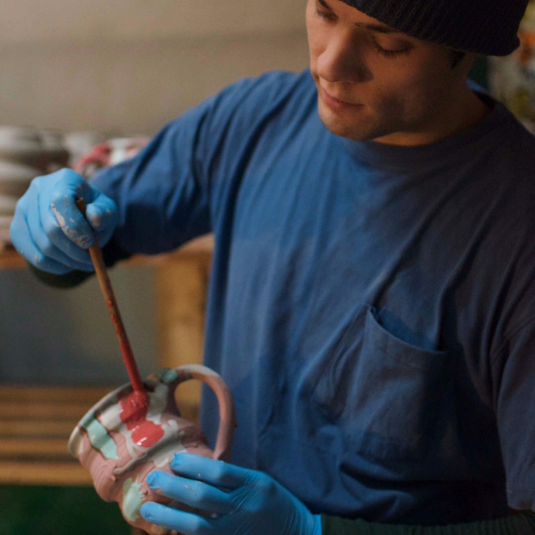 8joel-cherrico-pottery-holding-a-mug.jpg