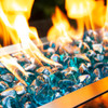 Caribbean blue fire glass diamonds in an outdoor fire pit.