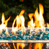 Flames dancing on tropical blue fire glass diamonds.