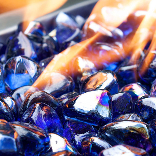 Close up of deep azure abyss blue fire glass diamonds in a fire pit