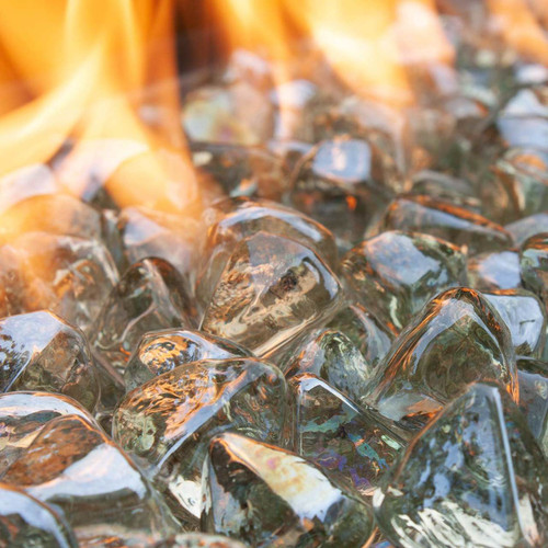 Clear Fire Glass Diamonds in flaming fire pit.