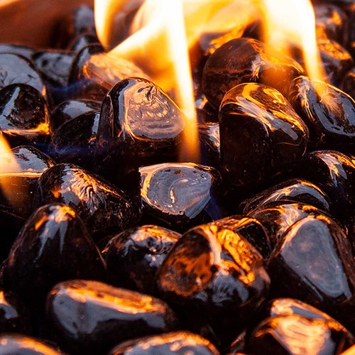 Close up of coal jet black fire glass rocks