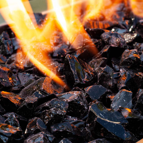 Close up of jet-black crushed fire glass rocks