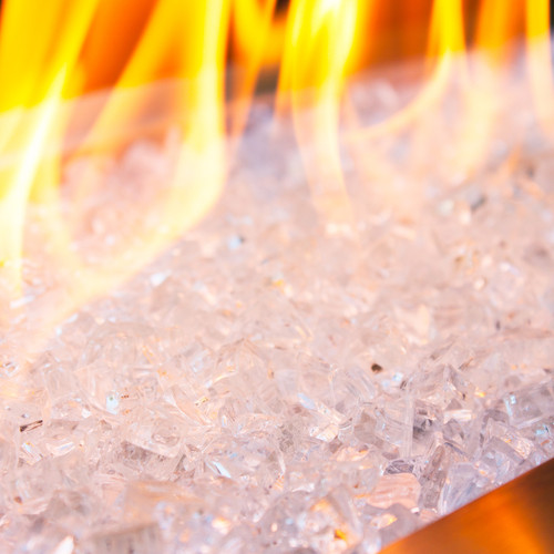 Close up of zircon-like tempered fire glass in a smoldering fire pit