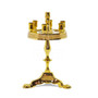 The candle stand is 7 inches tall and made of brass. There is an accent tone around the base of the candles as shown.