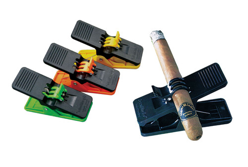 Cigar Minder (Available in Black, Green, Yellow, Orange)  All-Purpose Cigar Clip for People on the Move. Keeps Cigar in Place Without Any Damage to Wrapper. Clamp Holds Cigar Minder in Place Anywhere. Use on the Golf Course, the Boat or in the Back