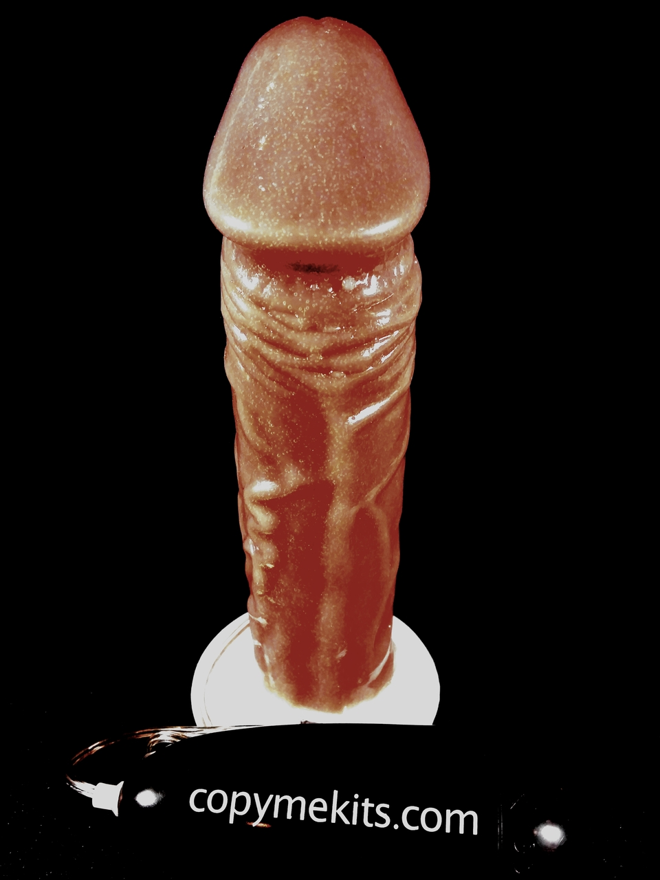 This is a Dark Skin Tone Suction Cup  Kit. Pictured is an example of a finished copy. YOUR COPY will look exactly like YOUR PENIS!