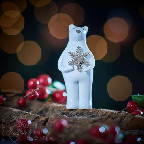 Bear holding Snowflake Decoration