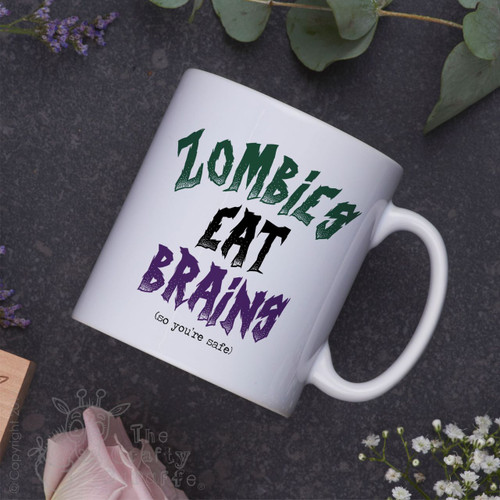 Zombies eat brains (so you're safe) Mug
