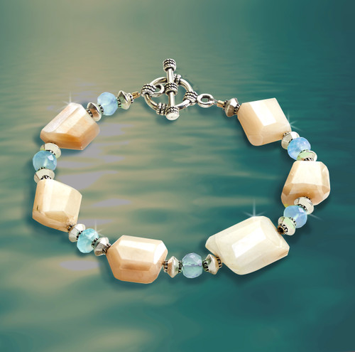 The Talent Enhancer Bracelet.  Energy channeled peach moonstone and blue apatite bring out the very best in you.