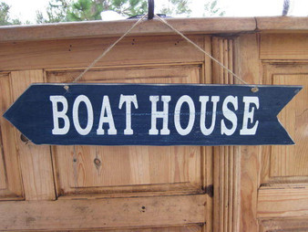 "Let our sign point the way to the boat!  Wooden Blue Boat House Sign.  Hangs buy a rope.  Size 24"" L x 5"" W."