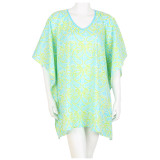 Green lightweight cotton tunic. Great for beach cover up.  Mid-thigh length.