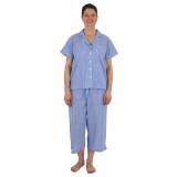 Woman wearing short sleeve top, capri pants cotton pajama set in blue & white stripe