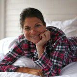 Woman in bed wearing soft 100% cotton flannel long sleeve pajama set