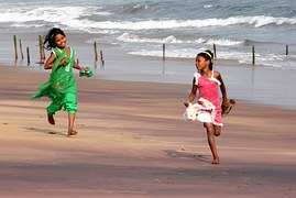 services_children_playing_running_sandy_beach