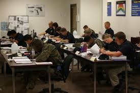 accompllishments_trainees_sitting_work_desk_studying