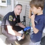 partners_supporters_law enforcement_officer_police_boy