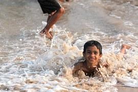 Maine_boy_swimming_ocean_Maine